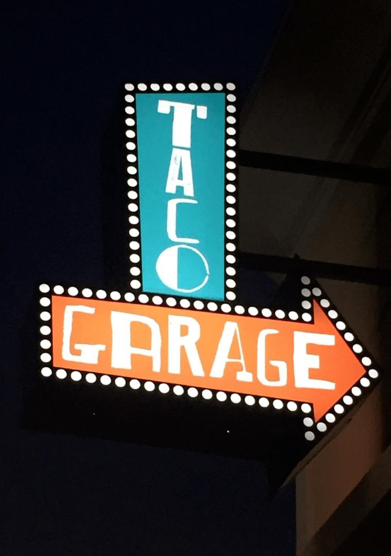 Taco Garage Sign at Night